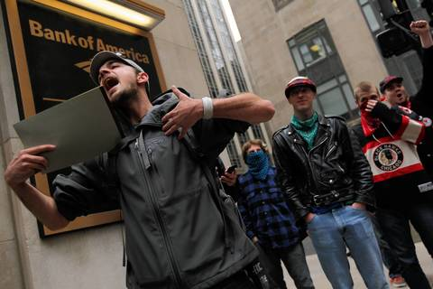 Occupy protesters chant about Bank of America getting federal benefits at 135 S. LaSalle St. in Chicago.