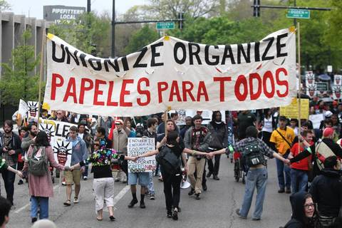 Protesters march to Federal Plaza from Union Park for May Day.