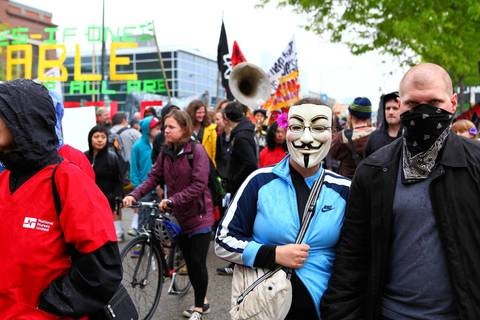 People march to Federal Plaza from Union Park for May Day.