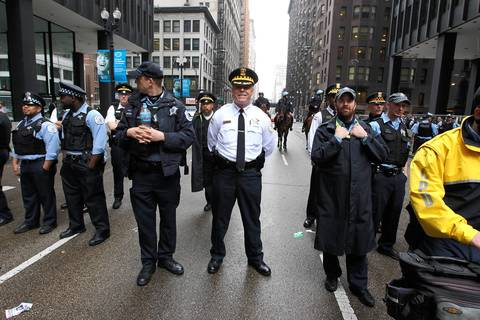 Chicago Police Superintendent Garry McCarthy smiles towards the camera as people rally in Federal Plaza after marching from Union Park for May Day.