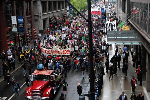 May Day protesters march along the route near the intersection of Jackson and Wells.