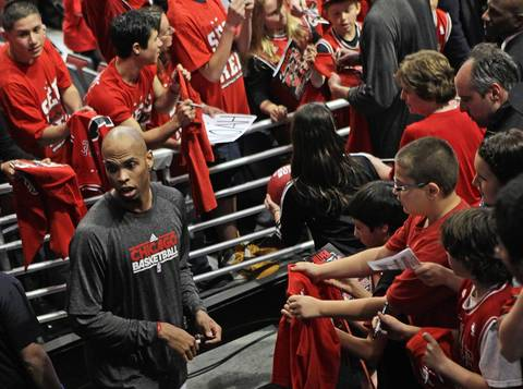 Chicago Bulls forward Taj Gibson (22) signs autographs before playing the Philadelphia 76ers in Game 2 of the first-round Eastern Conference Playoffs at the United Center.