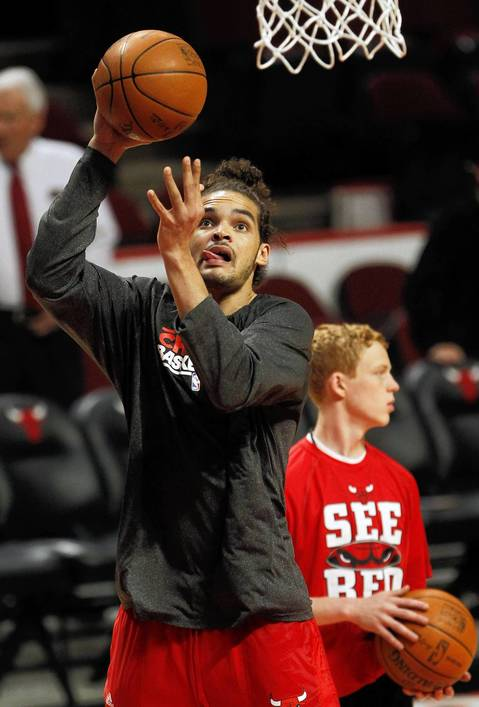 Chicago Bulls center Joakim Noah (13) warms up before playing the Philadelphia 76ers in Game 2 of the first-round Eastern Conference Playoffs at the United Center.