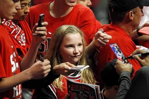 Bulls fans get autographs from Taj Gibson before the start of Game 2 against the Philadelphia 76ers.