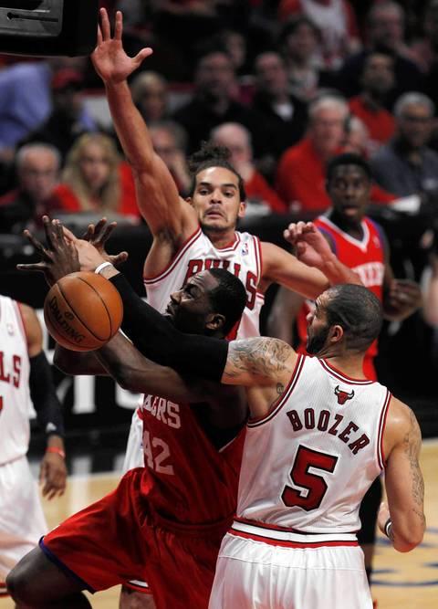 Chicago Bulls power forward Carlos Boozer (5) fouls Philadelphia 76ers power forward Elton Brand (42) during the first quarter.