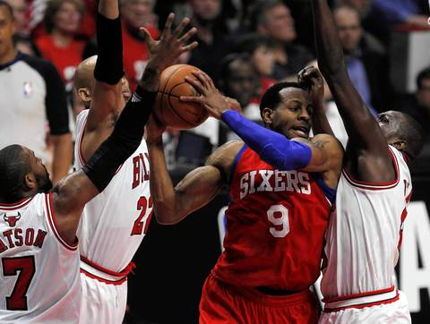 Philadelphia 76ers small forward Andre Iguodala (9) is defended by three Chicago Bulls in the first half.