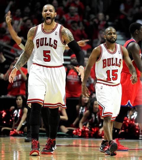 Chicago Bulls power forward Carlos Boozer (5) reacts after a basket by his teammate John Lucas (15) late in the second half.