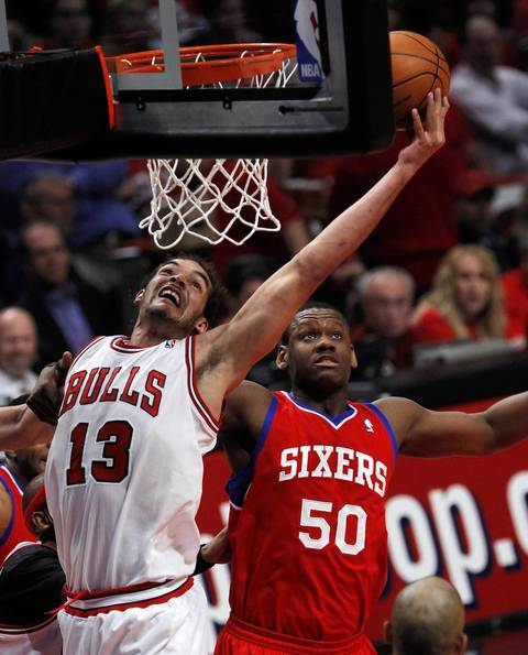 Chicago Bulls center Joakim Noah (13) tries to grab a rebound in front of Philadelphia 76ers power forward Lavoy Allen (50) in the first quarter.