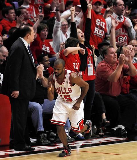 Chicago Bulls point guard John Lucas (15) celebrates a three-point basket against the Philadelphia 76ers.