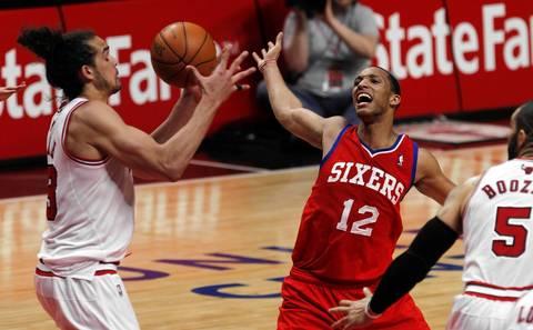 Chicago Bulls center Joakim Noah (13) takes the ball from Philadelphia 76ers shooting guard Evan Turner (12) during the second quarter.