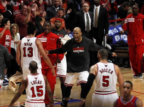 Chicago Bulls forward Taj Gibson (22) and the rest of the Bulls' bench greet Joakim Noah and John Lucas after a scoring run against the Philadelphia 76ers late in the second quarter.