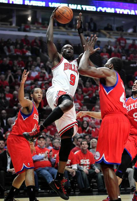 Chicago Bulls small forward Luol Deng (9) drives in to score against the Philadelphia 76ers during the first half.