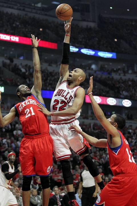 Chicago Bulls forward Taj Gibson (22) tries to dunk against Philadelphia 76ers forward Thaddeus Young (21) during the first half.