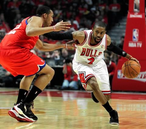 Chicago Bulls point guard C.J. Watson (7) heads up court against the Philadelphia 76ers.