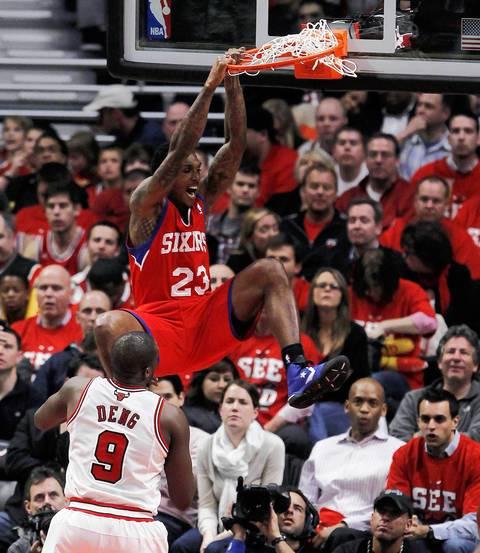 Philadelphia 76ers point guard Lou Williams (23) dunks over Chicago Bulls small forward Luol Deng (9) during the third quarter.