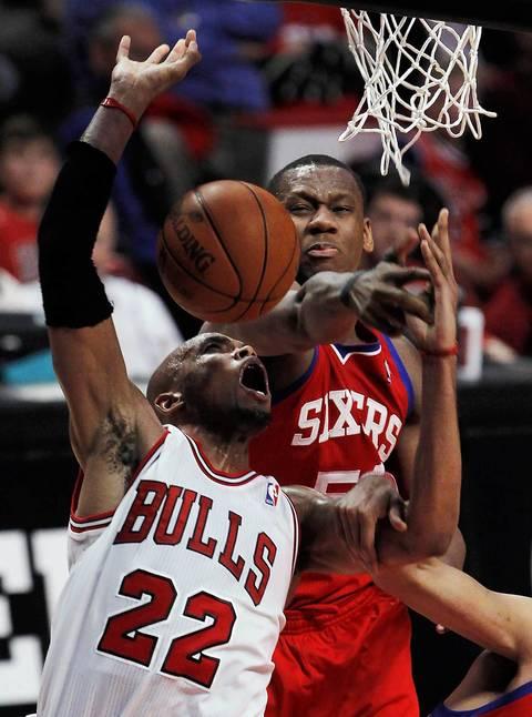 Chicago Bulls forward Taj Gibson (22) can't get up a shot against Philadelphia 76ers power forward Lavoy Allen (50) during the fourth quarter.