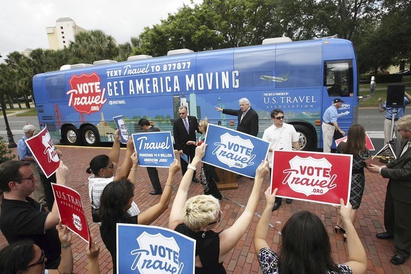 "U.S. Travel's ""Vote Travel"" bus, which is driving across the nation to promote tourism as a political issue, visits Orlando on Tuesday."