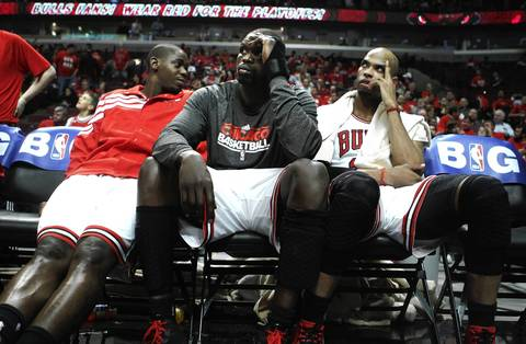 Chicago Bulls shooting guard Ronnie Brewer, with teammates Luol Deng (9) and Taj Gibson (22) sit on the bench late in the 4th quarter of the Bulls loss in Game 2 against the Philadelphia 76ers.