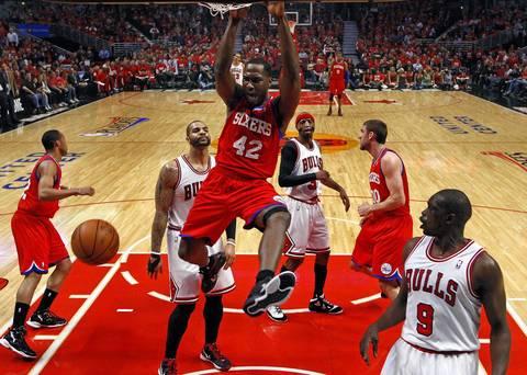 Philadelphia 76ers power forward Elton Brand (42) dunks in front of Chicago Bulls power forward Carlos Boozer (5) during the first half.