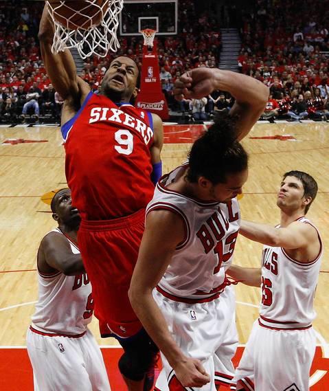 Philadelphia 76ers small forward Andre Iguodala (9) dunks over Chicago Bulls center Joakim Noah (13) during the second quarter.