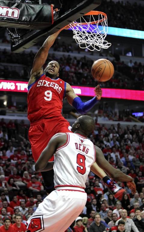 Philadelphia 76ers small forward Andre Iguodala (9) dunks on Chicago Bulls small forward Luol Deng (9) during the second half.