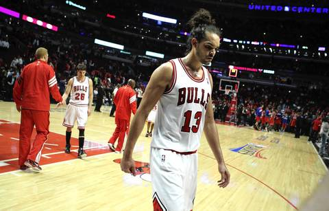 Chicago Bulls center Joakim Noah (13) walks off the court after the Bulls lost in two of a first round NBA playoff game to the Philadelphia 76ers.