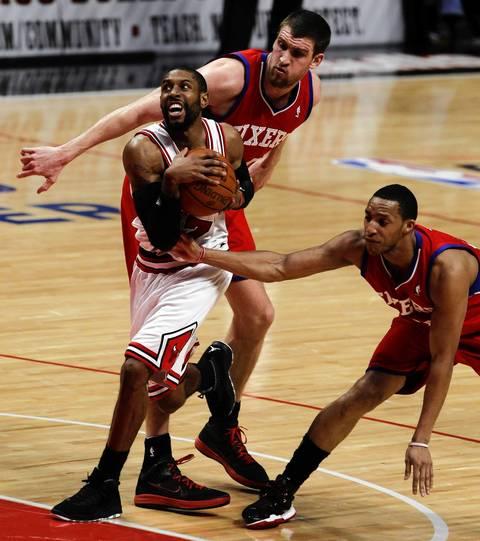 Chicago Bulls point guard C.J. Watson (7) tries to get past Philadelphia 76ers shooting guard Evan Turner (12) during the third quarter.