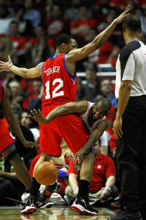 Chicago Bulls point guard John Lucas (15) tries to pass around Philadelphia 76ers shooting guard Evan Turner (12) as he applies defensive pressure during the 4th quarter.