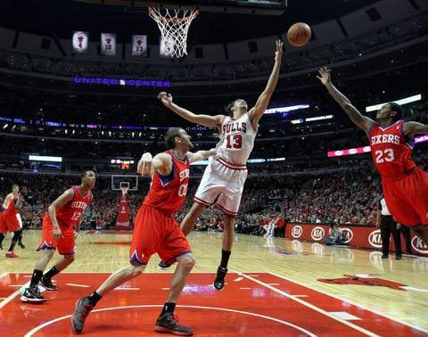 Chicago Bulls center Joakim Noah (13) tries to grab a rebound against Philadelphia 76ers point guard Lou Williams (23) during game two.