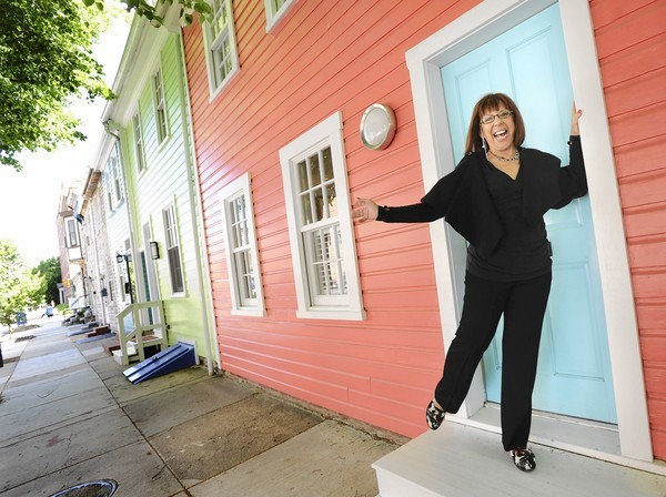 Myrna Poirierstands at the door of her dream home on S. Ann St.