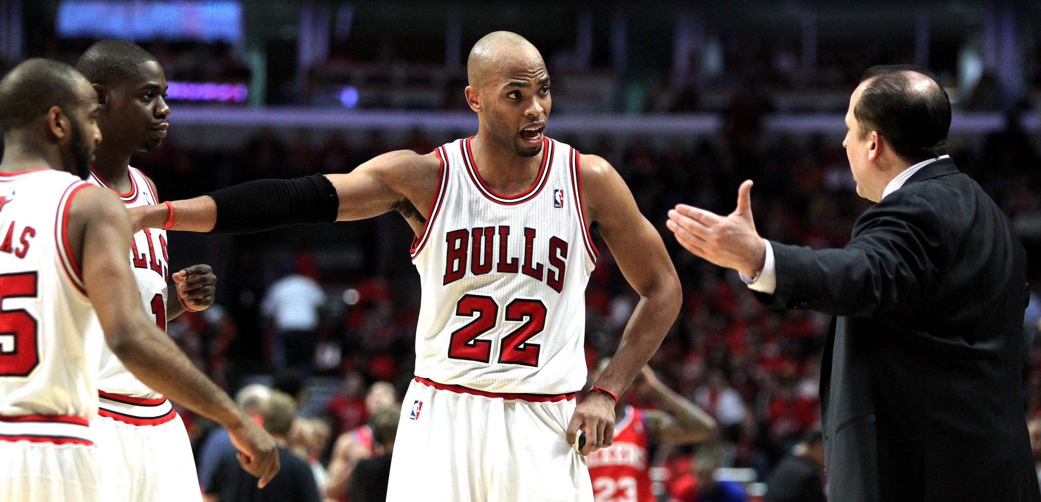 Bulls forward Taj Gibson (22) talks with coach Tom Thibodeau in the second half. (Chris Sweda/Tribune photo)