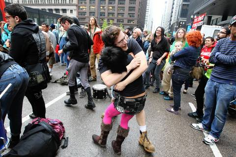 People rally in Federal Plaza after marching from Union Park for May Day.