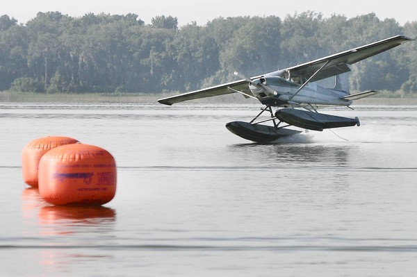 A seaplane touches down on one runner in front of markers in Lake Dora during the Seaplane Fly-in at the Tavares Seaplane Base in Wooton Park on Saturday, April 28, 2012.