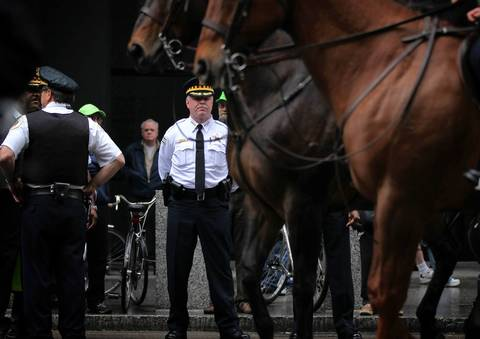 """Chicago Police Sup. Garry McCarthy watches May Day protests near Federal Plaza. McCarthy pronounced the day a success. """"I think it went extremely well,"""" he said. """"We haven't had any issues."""""""
