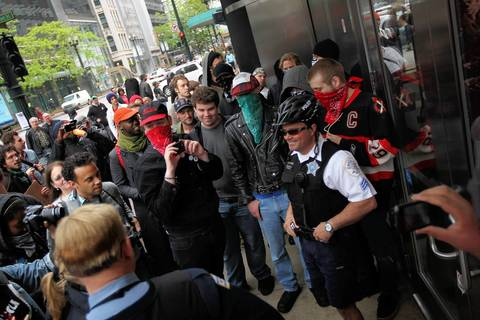 Occupy and May Day protesters block the entrances of a Bank of America location on State Street.
