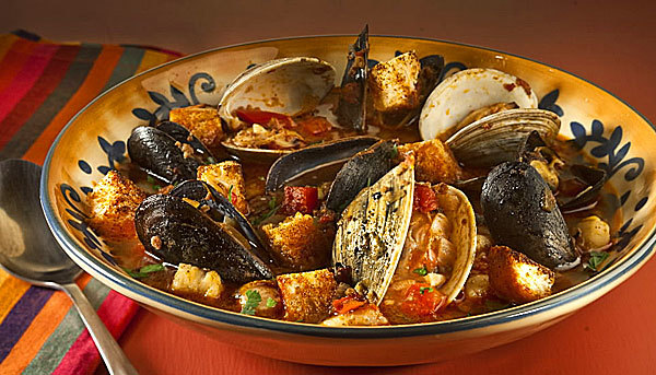 Chorizo-laced stew: The only difficult task turned out to be finding clams and mussels. Ordering ahead proves the ticket to success. But there are other options  shelled shrimp, diced firm fish, even lobster.