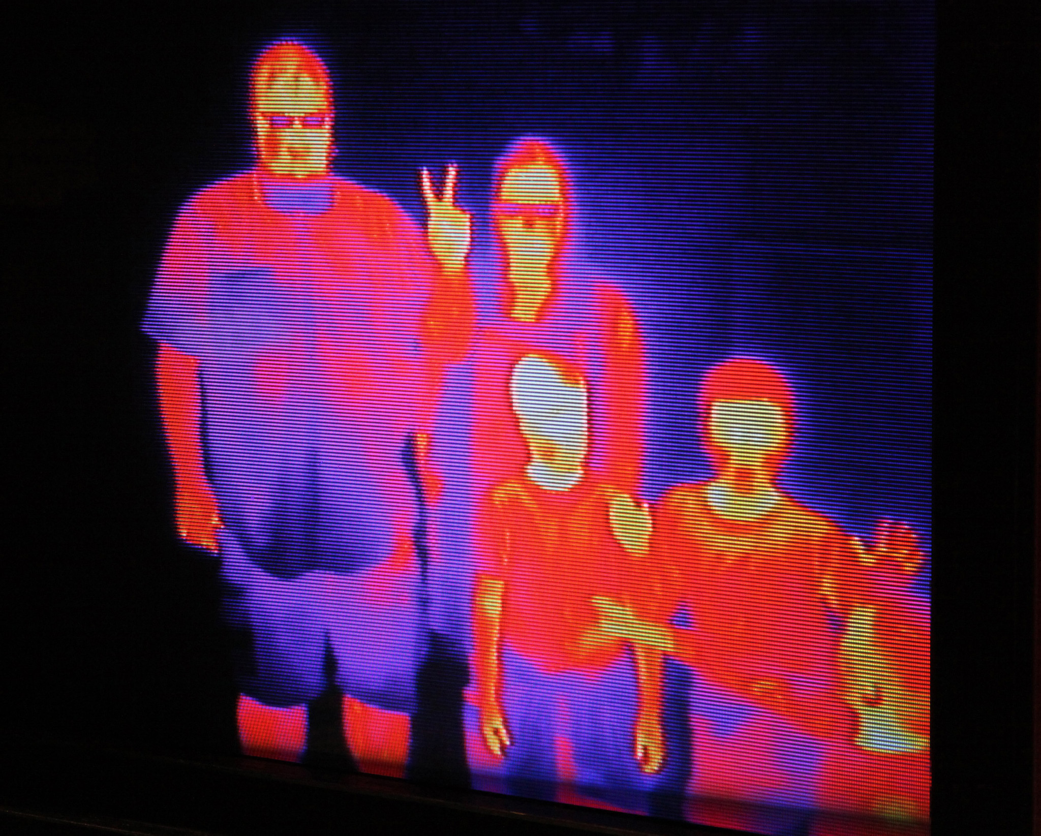 An infrared camera shows family members in a different light at the Oregon Museum of Science and Industry in Portland, Oregon.