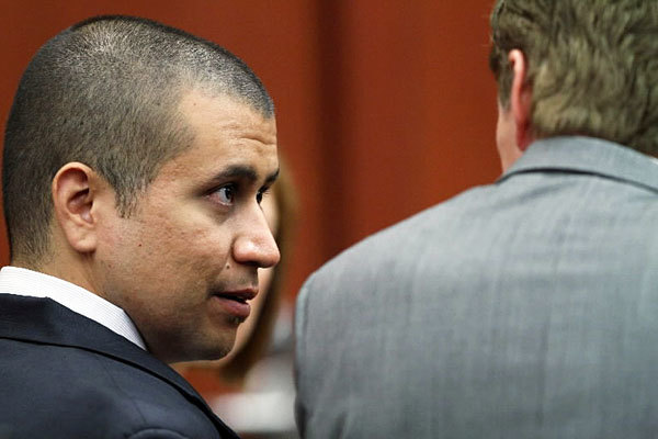 George Zimmerman, left, talks with his attorney, Mark O'Mara, in a Seminole County courtroom during his bond hearing on April 20, 2012, in Sanford, Florida.