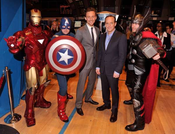 Actors Tom Hiddleston(third from left) and Clark Gregg(second from right) pose for a photo as part of a celebration of the release of Marvel Studios' 'Marvel's The Avengers' after ringing the opening bell at the New York Stock Exchange on May 1, 2012 in New York City.