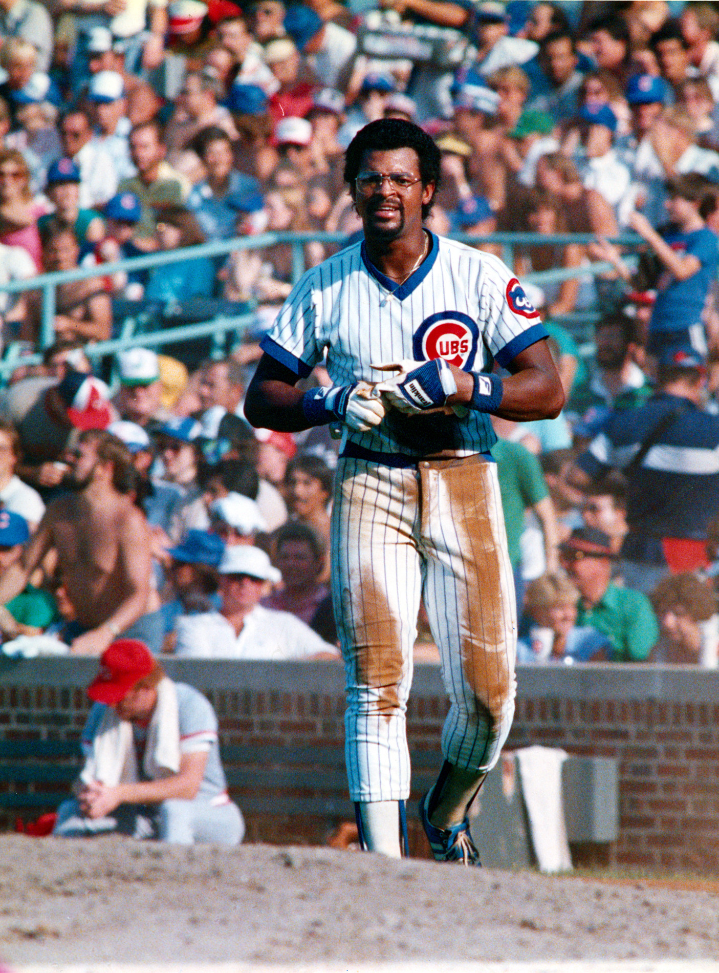 Leon Durham walks back to the dugout during a game.