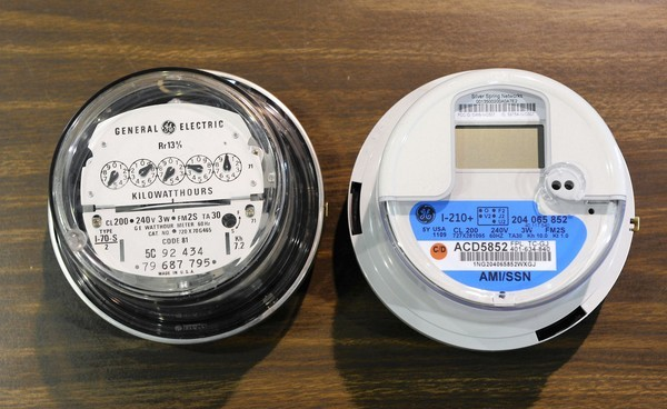 "A conventional meter, left, and a ""smart"" meter."