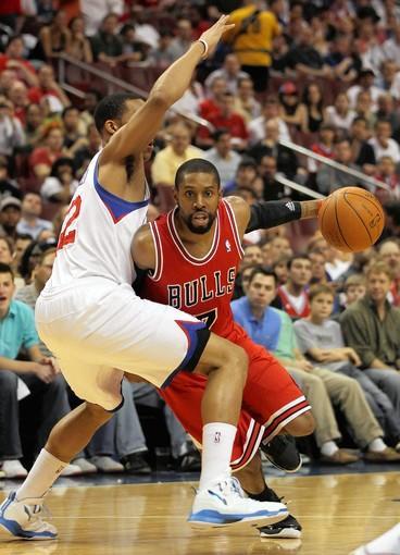 Chicago Bulls' CJ Watson drives against Philadelphia 76ers' Evan Turner in 1st quarter during Game 3 of NBA Eastern Conference Quarterfinals at Wells Fargo Center in Philadelphia.