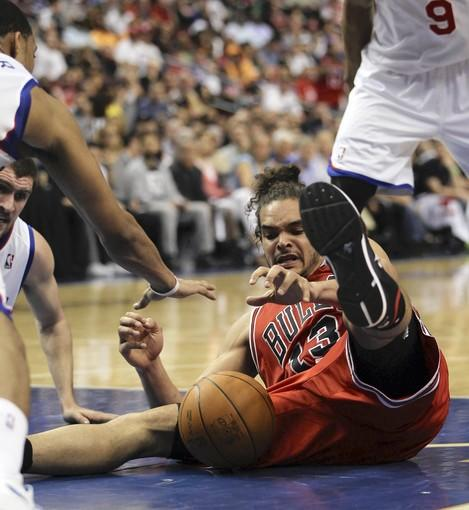 Chicago Bulls' Joakim Noah reaches for s loose ball against Philadelphia 76ers in 2nd quarter during Game 3 of NBA Eastern Conference Quarterfinals at Wells Fargo Center in Philadelphia.