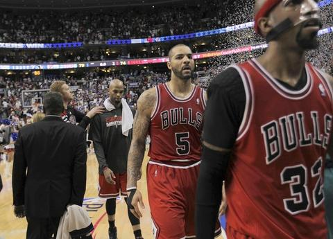 Richard Hamilton, Carlos Boozer and Taj Gibson leave court after the 79-74 loss.