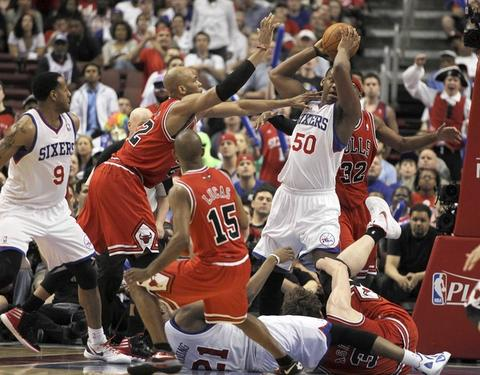 Chicago Bulls' Taj Gibson tries to harass Philadelphia 76ers' Lavoy Allen during Philadelphia's 79-74 win in Game 3 of NBA Eastern Conference Quarterfinals at Wells Fargo Center in Philadelphia.