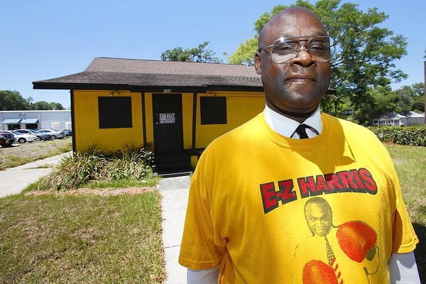 Former City Council candidate Ezell Harris, in front of his now-boarded-up campaign headquarters, goes on trial June 4.