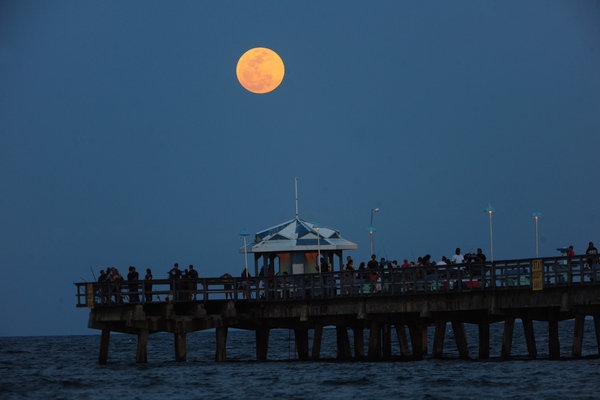 "The ""Super Moon,"" rises over Anglin's Pier in Lauderdale-by-the-Sea, Saturday May 5, 2012. The unusual occourance of a full moon while making its closest approach to Earth this year  a mere 221,802 miles away, made for a spectacular moonrise."