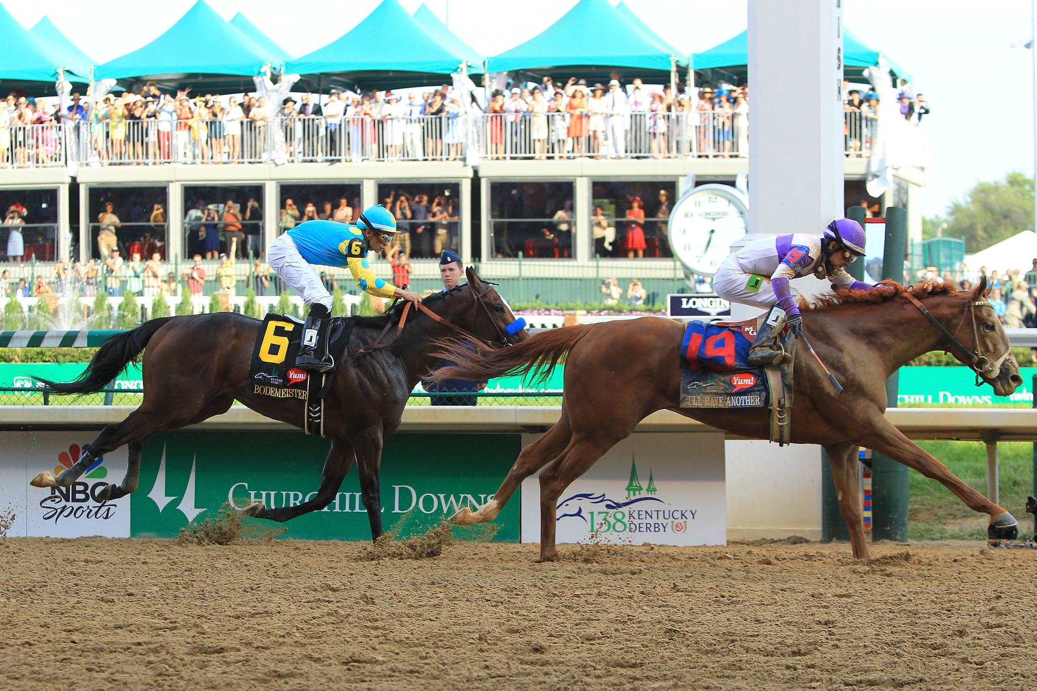 Mario Gutierrez celebrates atop I'll Have Another after winning the 138th running of the Kentucky Derby ahead of Bodemeister ridden by Mike Smith.