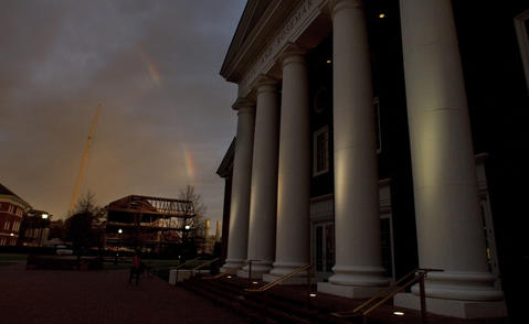 A rainbow breaks into view over new construction at Christopher Newport University framed by the Trible Library early Tuesday morning. A front bringing rain and falling temperatures will converge on the area Tuesday.
