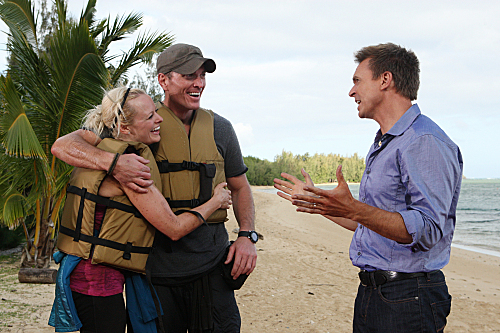 Host Phil Keoghan (right) speaks with Army couple Rachel and Dave.